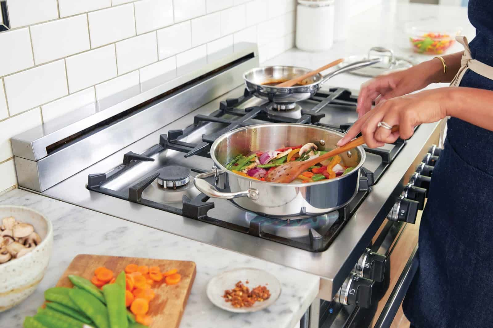 Fresh vegetables sauteed on stove in home-based restaurant