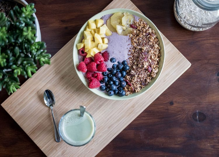 Breakfast protein bowl with fresh fruit and granola prepared by a home-based cook to be ordered on the HomeMade App