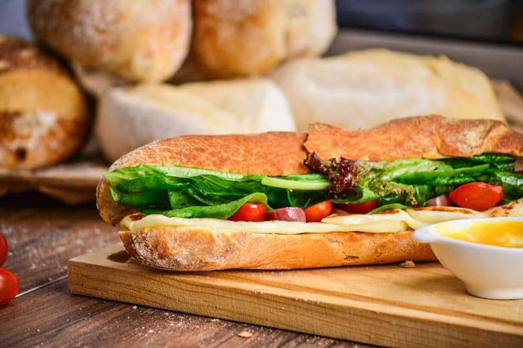 A homemade sandwich with fresh vegetables prepared for customers to order homemade food online